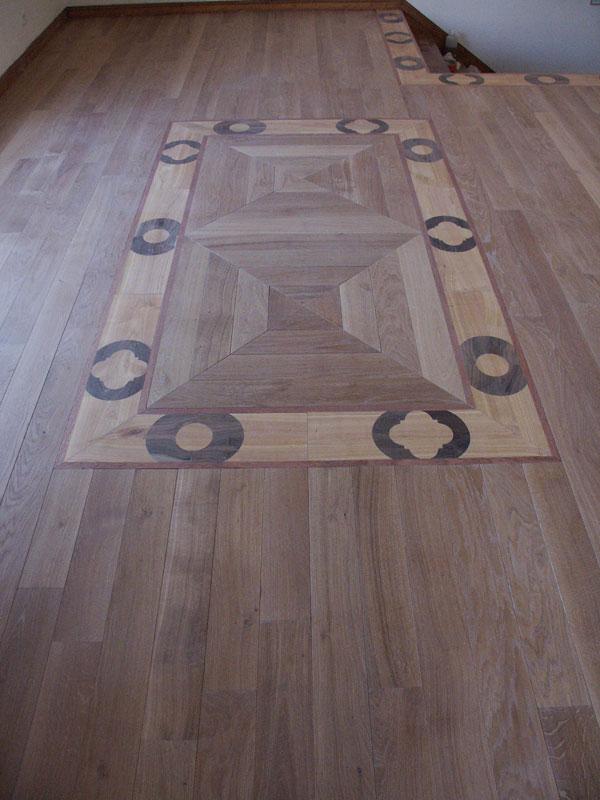 un decor de parquet original sur mesure parquet personnalis avec tapis central n 70. Black Bedroom Furniture Sets. Home Design Ideas