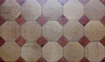 End grain Octagonal parquet floor in oak with cabochons in red wood